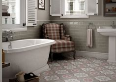 A cushy armchair in the bathroom gives you a comfortable place to sit while changing.