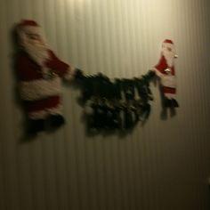 Plastic canvas Santas hold the words jingle bells
