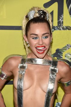 Miley Cyrus sticks out her usual tongue pose at the 2015 VMAs.