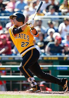 Jung Ho Kang of the Pittsburgh Pirates hits a RBI single in the first inning during the game against the Washington Nationals at PNC Park on...