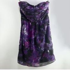 Lauren Conrad floral print dress 100% Polyester This dress is GORGEOUS!! Beautiful Purple & Fuschia Floral Print on a Black Background The Bodice has Intricate Pintucks For Added Interest  Corset Stays on Each Side Help Keep it in Place As Well as Rubberized Inside Edge Fully Lined - Back Zipper Tag says 8 but fits like 6. Lauren Conrad Dresses Mini