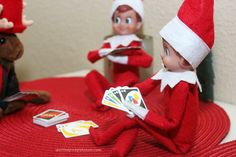 Elf on the Shelf, UNO! Elf trio playing UNO with miniature cards.