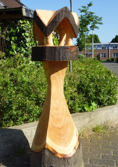 bird feeder, out of white oak. made with chainsaw. vogelvoederhuisje van…