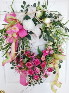X-lg Spring Summer Wreath This is a birch wreath that I filled with White Peonies, Pink Roses,Green Bellflowers,White Amaranthus, Pink Echinachia, Pink Poppies and Greens. There is honeysuckle vine woven throughout to give it a wild and woodsy look. I used several different