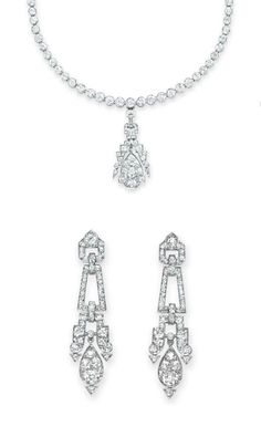 A SET OF ART DECO DIAMOND JEWELRY Comprising a necklace, suspending a detachable old European and baguette-cut diamond pendant, to the graduated collet-set diamond neckchain; and a pair of ear pendants en suite, mounted in platinum, necklace 14½ ins.