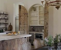 If only there was a bar hidden behind all pairs of antique doors! By designer Annelle Primos.