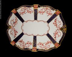 A stunning tray measuring 45.5cm (18 inches) across from exquisitely gilded handle to handle. The imari design is almost Egyptian and very lovely with panels of cobalt blue and white alternating. A real treasure for the Royal Crown Derby collector.