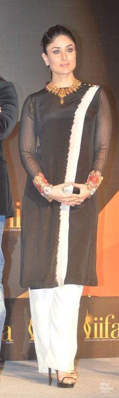Kareena @ IIFA Press Conf Feb, 14, in a tie-dyed Kameez by http://www.AnandKabra.com/ w/ colourful buttons on the shoulder & thick floral cuffs. Comfortable pajamas & statement gold jewelry by Maheep Kapoor https://twitter.com/maheepkapoor completed her simplistic look.