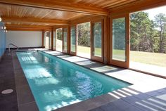 An Extravagant Swimming Pool Inside Semi Modern House : House Indoor  Swimming Pool Idea With Inground Swimming Pool With Liners And Ladder  Wooden Ceiling ...