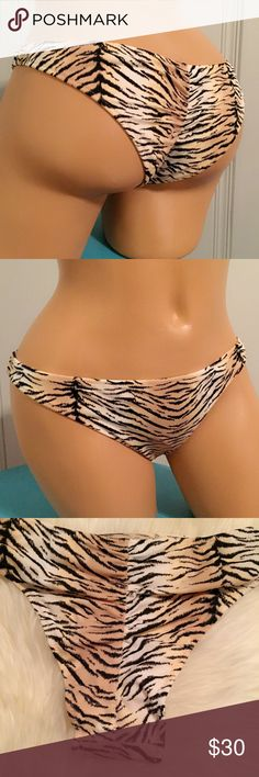 Victoria Secret Tiger Itsy Ruched Bikini Bottom All kinds of sexy, this teeny bikini combines a low rise and ruching at the back in a teeny-tiny Brazilian shape. From our fun, flirty Beach Sexy Swim Collection.  Color - Natural Tiger (6XQ) Size - S & M Condition - New in Package (Only opened for pictures)  Low rise Minimal back coverage Lined Ruched back Imported nylon/spandex Victoria's Secret Swim Bikinis