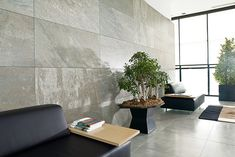Ston-Ker Porcelain Tile | Porcelanosa's Wall Tile: Arizona Stone; Floor Tile: Microcemento Gris
