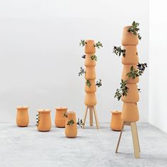 A version of these could probably be made with terra cotta pots.