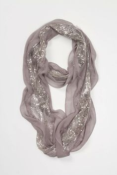 A shimmery snow sparkle scarf will add a lot to a look