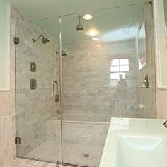 BathShower combo Stand up shower with a soaking tub behind it
