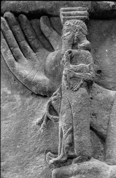 A Neo-Assyrian relief, a detail of a throne and the hand of the carrying attendant, from Dur Sharrukin (Khorsabad), 721-705 B.C.