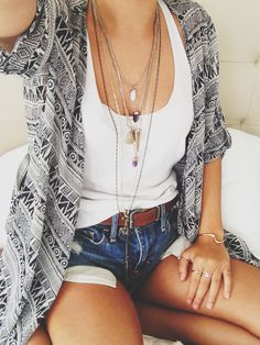 love the scarf/kimono with the tank and necklaces, don't love the shorts for me.
