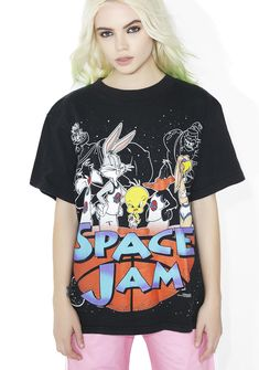 727e9f0385b6 Vintage Space Jam Tee features a colorful character graphic on the front.  Loose fitting and