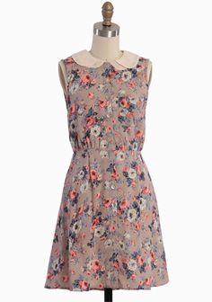Fairytale Roses Button-up Dress 46.99 at shopruche.com. Simply enchanting, this lightweight taupe dress is adorned with a romantic floral print in soft hues, a cream chiffon peter pan collar, and a single front pocket. Finished in a vintage-inspired silhouette with front button closures and a flattering...