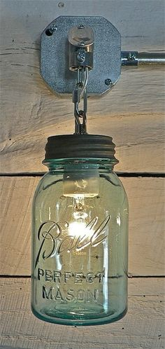 mason jar light -- so sweet for screened porch! I have managed to pick some of these up at clearance sales!!! What a great idea!