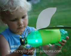 firefly craft your kids will love to make this pop bottle craft this summer! a green pop bottle is transformed into a firefly using a glow stick. my kids just l Bug Crafts, Camping Crafts, Crafts For Kids, Taco Crafts, Glow Crafts, Camping Tips, Summer Crafts, Summer Fun, Uses For Plastic Bottles