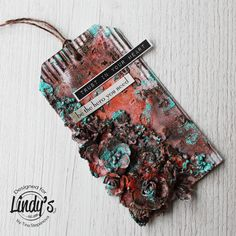 Hi gang! It's Tina here today to share with you a mixed media tag made with Lindy's Magical Shakers and Embossing Powder. I started with applying a white gesso on a corrugated cardboard…