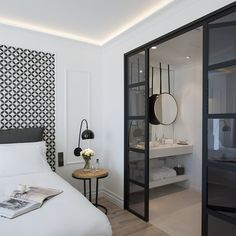 The area was once a fishing enclave, and its history is echoed in the choice of colours and of materials. As well as the industrial heritage aspects, Martinez has recalled design elements of yesteryear, such as the tiles – popular floor coverings in the Modernista era – which now find a new purpose as headboards...