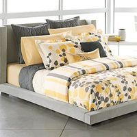 White bedspread, yellow sheets, dark bed, gray accents-a