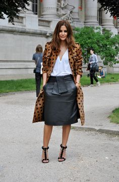 On the street in Paris. Leather skirt with white top and maj pumps