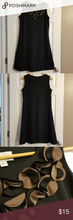 "Black Sleeveless Dress Never worn! Black A-line sleeveless dress, fully lined with fun black/taupe detail on front neckline. 74% polyester, rest is rayon/spandex. Easy comfortable fabric with few wrinkles. Pullover styling. Wear casually or under blazer or cardigan to work. I am 5'4"" and it falls just below my knee. Ronni Nicole Dresses Midi"