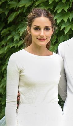 Olivia Palermo // wedding ponytail and three piece dress with sweater // Vogue