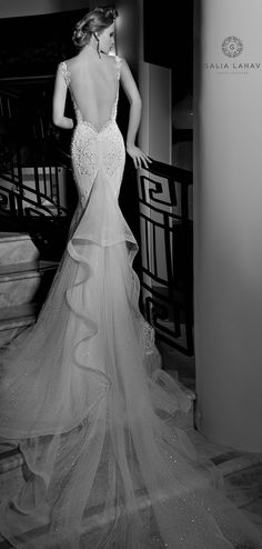 Galia Lahav Haute Coutre - Isadora is a classic mermaid dress with a geometric graphic spiral embroidery. Cleavage detailed with a sheer fabric. The bottom of the skirt has a silk tulle ruffle and a dramatic sparkled tulle train trim with cirn dentelle.