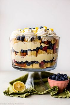 This show-stopping lemon berry trifle recipe includes lemon pound cake, fresh berries, a lemon cheesecake filling, and fresh whipped cream. Recipe on sallysbakingaddiction.com