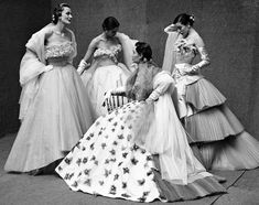 Jaques Fath showstoppers in Paris, 1951. Gordon Parks challenged prevailing rules about how to photograph fashion, including objects, group poses and streetscapes that beckoned with the allure of a desired lifestyle or career. (Photo: Gordon Parks, courtesy the Gordon Parks Foundation)