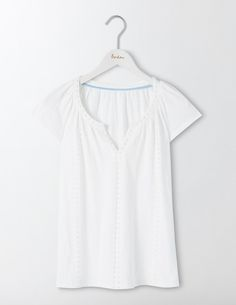 Embrace laid-back luxe in this soft jersey tee with unique French knot detailing. The capped sleeves and notch neck are super flattering, and the easy fit will keep you comfortable. Pair with jeans to lead a masterclass in simplicity, or slip on over a bikini when you want a bit of cover.