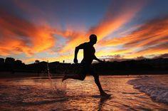 A swimmer runs into the water at dawn at Bondi Beach in Sydney, Australia.