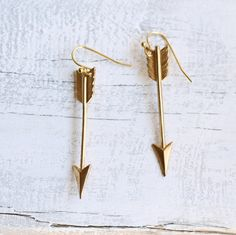 These great earrings are brass arrows that measure about 40mm (an inch and a half) long. I have added simple gold plated ear wires.