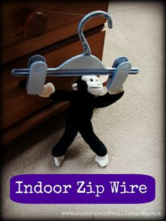 Use string, a hanger, and a stuffed animal to make an indoor zip wire.