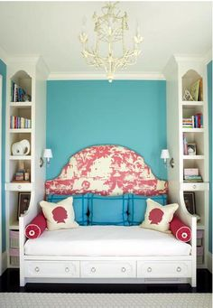 White pillows with bright fabric for silhouettes.  (Might I add the chandelier and the colors are marvelous.