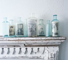 Print out copies of old family photos in black + white then place them in charming old glass bottles. Photo by Kindra Clineff.