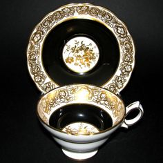 teacup with golden arabesques