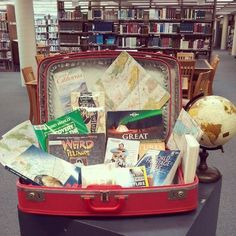 Travel Display - The Anderson Library Great display and an awesome suitcase to match.
