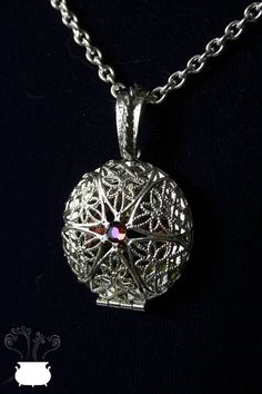 Love Talisman Locket With Herbal magical mixture by witchemporium, €15.00