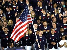 Olympic swimmer Michael Phelps leads the US Olympic team during the opening ceremony in Rio. Few athletes will reach his level of wealth and success. Olympic Swimmers, Olympic Athletes, Olympic Team, Olympic Games, Nbc Olympics, Rio Olympics 2016, Summer Olympics, Rio Olympics Opening Ceremony, Red Day