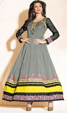 A Grey Georgette anarkali with black sleeves and embroidery on york, shoulders and hemline.The suit set comes with 3 pieces, an unstitched salwaar, a semi stitched kurti/anarkali and a fully finished dupatta.