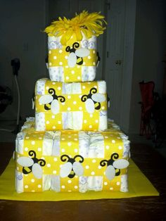 Square Honey Comb bumble bee diaper cake! Good idea for a real cake