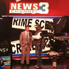 WREG reporter/anchor Adam Hammond and photographer Keith Wheatley chat about footage before a morning update.