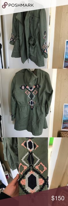 """Free People Embroidered Twill Parka Jacket Gorgeous in person, in size small. Oversized style so might fit up to large. Distressed cargo jacket with tribal-inspired embroidery on the sleeves and back. Drawstring ties at front of neckline and waist. Zipper opening in front. Four front snap pockets. Hooded. Lined. Measure about 30"""" L, 23"""" bust. 97% Cotton 3% Spandex. Good used condition.Slight pilling on embroidery. ❌No trades. Thank you. Free People Jackets & Coats"""