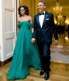 Michelle Obama Kennedy Center Honors, December 2013 | Gorgeous! The First Lady looked regal beside President Obama at the Kennedy Center Honors gala in Washington, D.C. in December, wearing a gorgeous, teal green Marchesa gown that included off-the-shoulder ruching on the bodice.