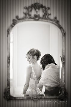 new york wedding at the St. Regis Hotel - the bride in the mirror while getting dressed  - photo by brian dorsey studios