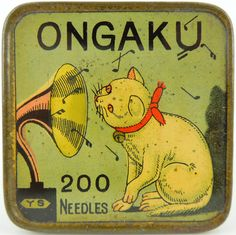 ONGAKU means Music in Japanese. This is a wonderfully designed tin and a very interesting take of the Nipper design where you had a dog listening to a gramophone.